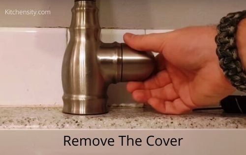 Remove the moen faucet cover